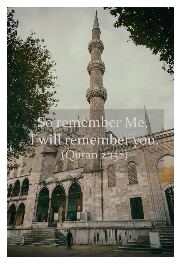 Quranic inspirational verses - An unidentified man walks on the compound of a mosque with vintage filter.  stock photos