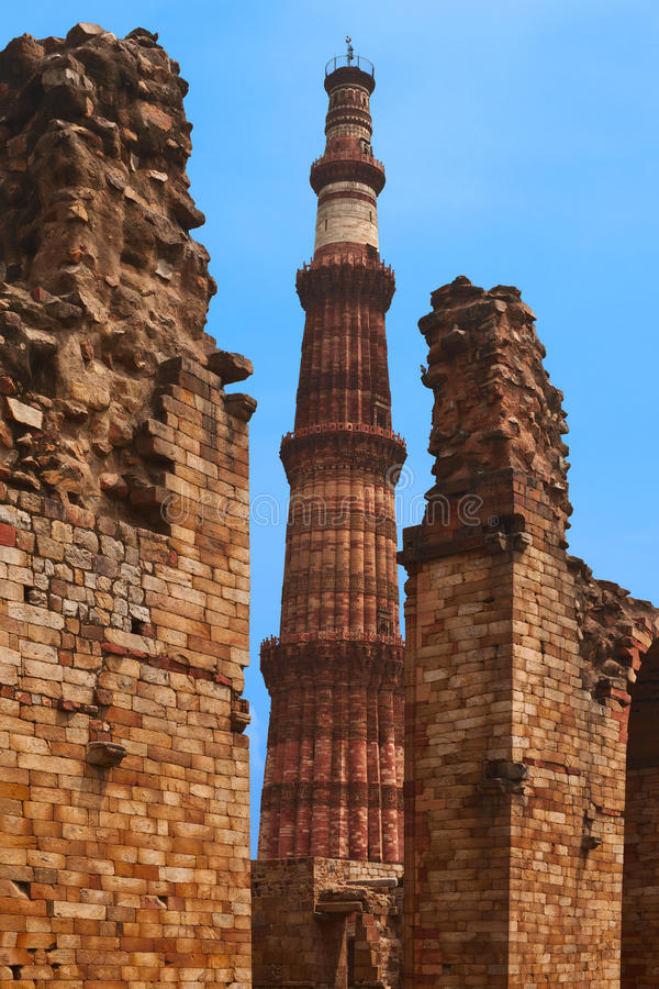 Qutub Minar. Ancient islamic monument - Qutub Minar is the tallest minaret in India, made of red sandstone covered with intricate carvings and verses from the stock photo