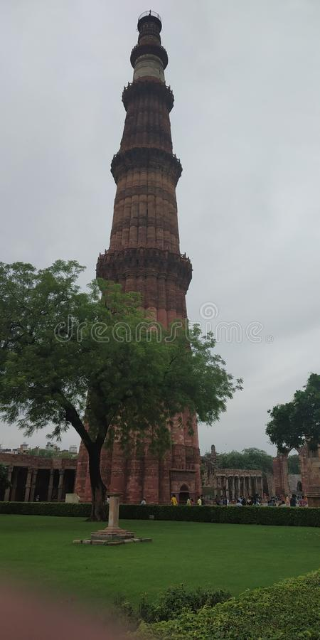 Qutub minar is really awesome place in India. This is the picture of Qutub Minar. rnWhen you will go on that place then you will get realize that is really royalty free stock image