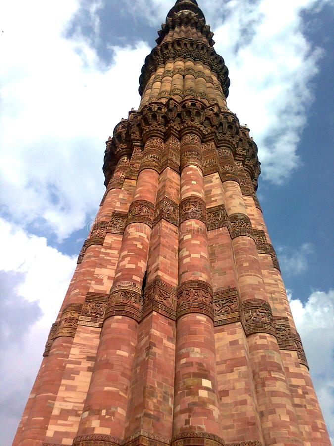 Qutub minar delhi. Qutub minar are made by red stone and the  last two are made of marble and sandstone royalty free stock photography