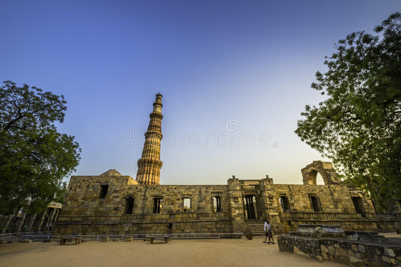 Qutub Minar. Is a minaret that forms part of the Qutb complex, a UNESCO World Heritage Site in the Mehrauli area of Delhi, India. Its design is thought to have royalty free stock photo
