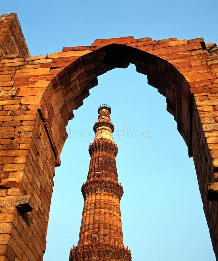 Qutub Minar Mosque, Delhi, India. View through arch to the Qutub Minar Mosque (The worlds tallest free standing minaret), Old Delhi, Delhi Union Territory royalty free stock photography