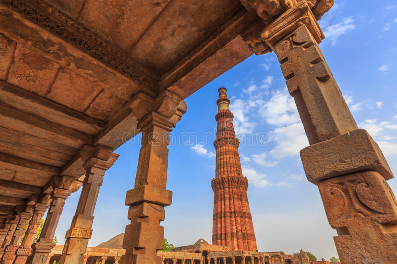 Qutub Minar. The tallest minaret in India is a marble and red sandstone tower that represents the beginning of Muslim rule in the country stock photography
