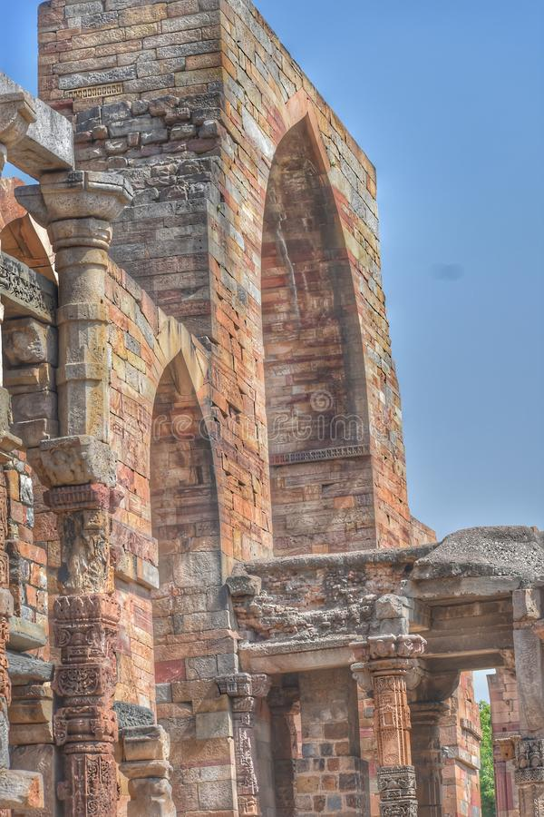 Qutub Minar Walls. The Qutb complex are monuments and buildings from the Delhi Sultanate at Mehrauli in Delhi in India. The Qutub Minar `victory tower` in the royalty free stock photography