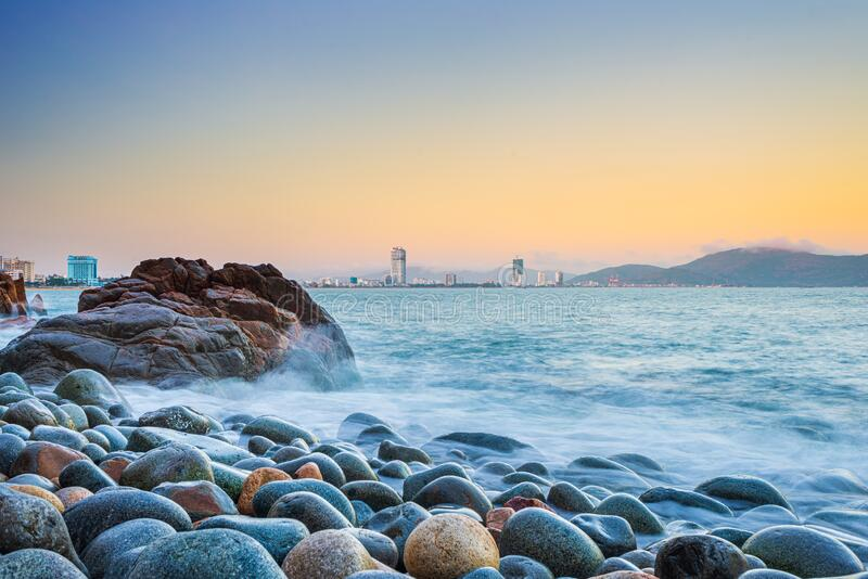 THƠ ĐỜI PHẠM BÁ CHIỂU - Page 3 Quy-nhon-city-panorama-pebble-beach-rock-boulders-foreground-famous-tourism-destination-vietnam-bay-soft-sea-waves-172706933