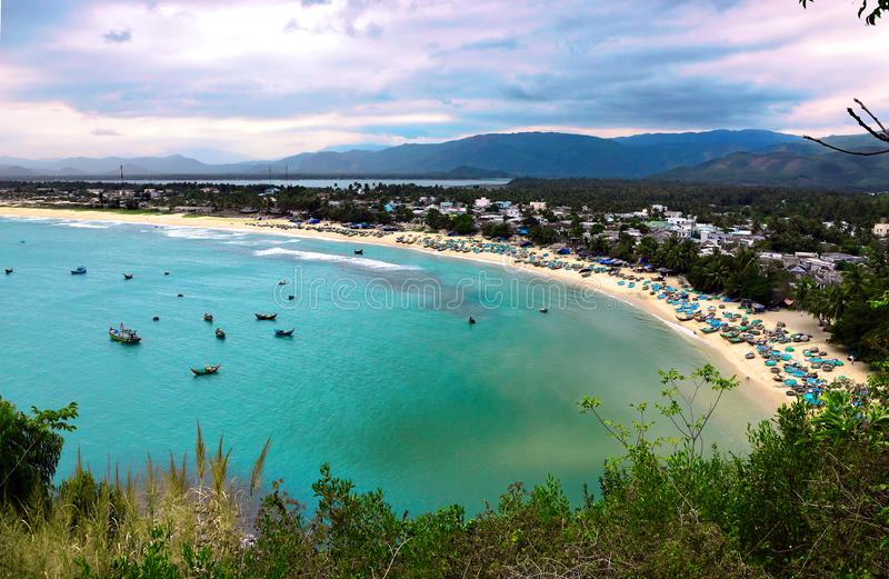 Quy Nhon, Vietnam fishing village. Small fishing village near by Quy Nhon, Vietnam. Turquoise sea and beautiful beach. Mountains in the background royalty free stock photo
