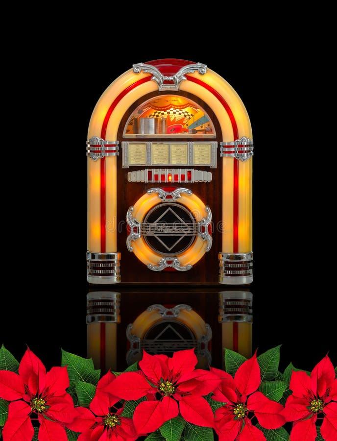 Rádio do jukebox com o ornamento vermelho do Natal da flor da poinsétia imagem de stock royalty free