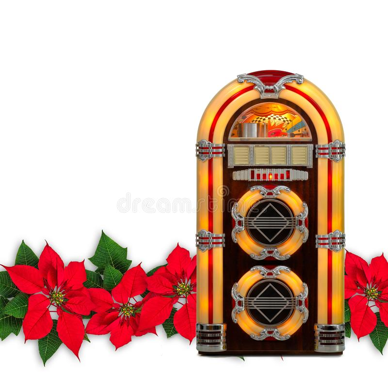 Rádio do jukebox com o ornamento vermelho do Natal da flor da poinsétia imagem de stock