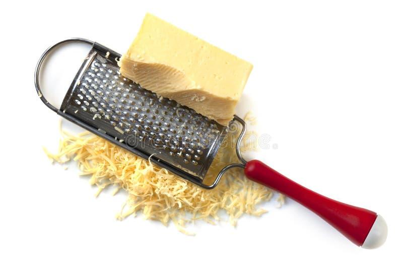Râpe de fromage avec le cheddar photographie stock libre de droits
