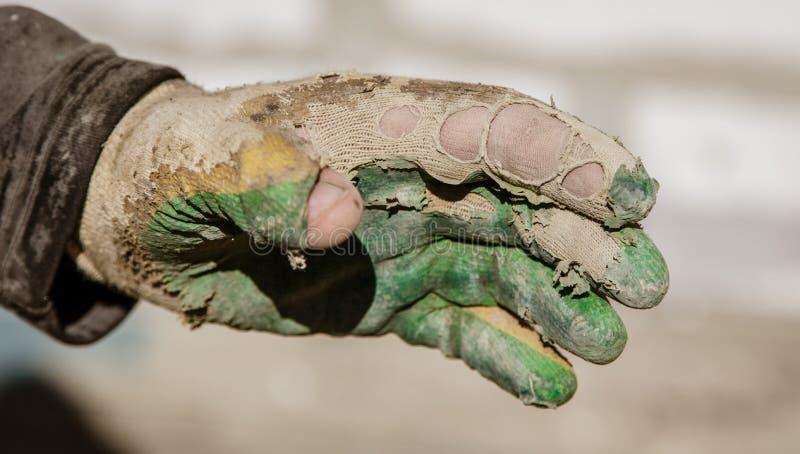 Rękawiczka na ręce budowniczy zdjęcie royalty free