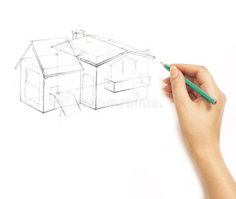 Räcka att dra ett hus med en blyertspenna på en vit arkivfoton