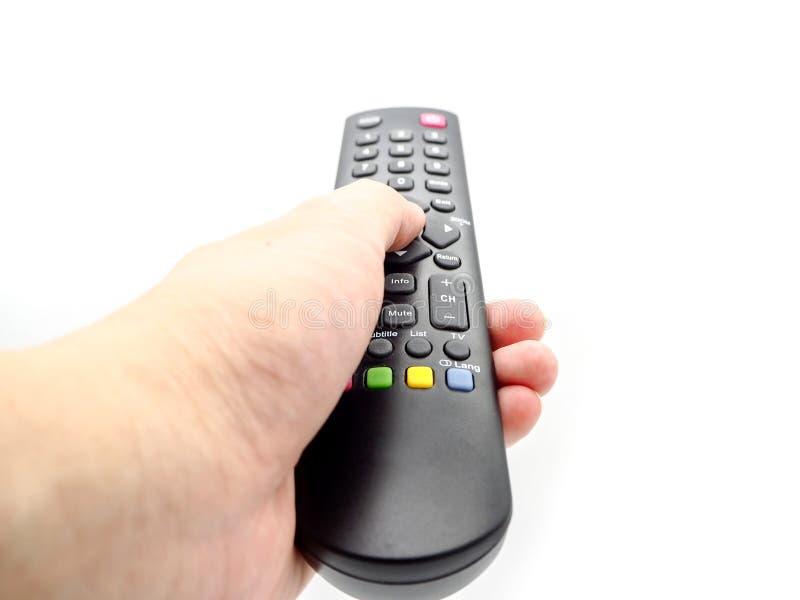 Räcka att rymma en fjärrkontrollTV isolerad på vit bakgrund arkivbild