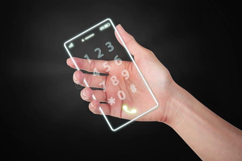 Räcka den digitala hållande ljusa mobiltelefonen framtiden på mörk backgro arkivfoton