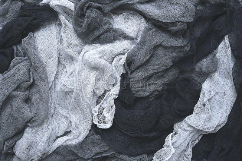 Räcka färgat pastell färgat flortyg i grå färger arkivfoton