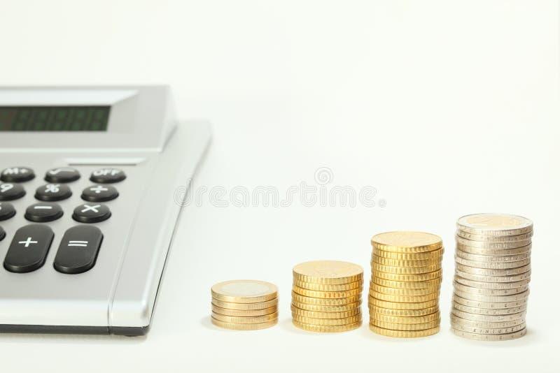Räknemaskin- och pengarmynt arkivbild