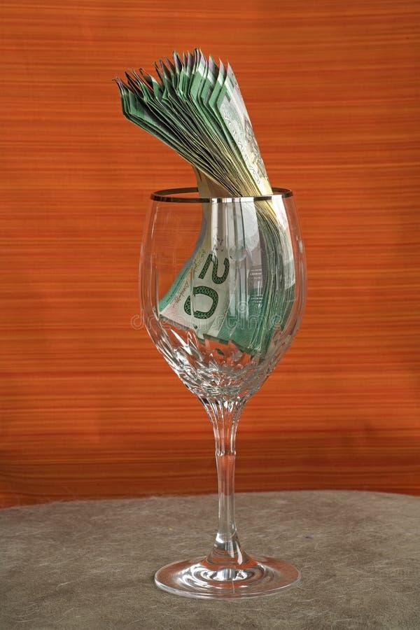 Räkning CAD för pengar 033 i exponeringsglas arkivbilder