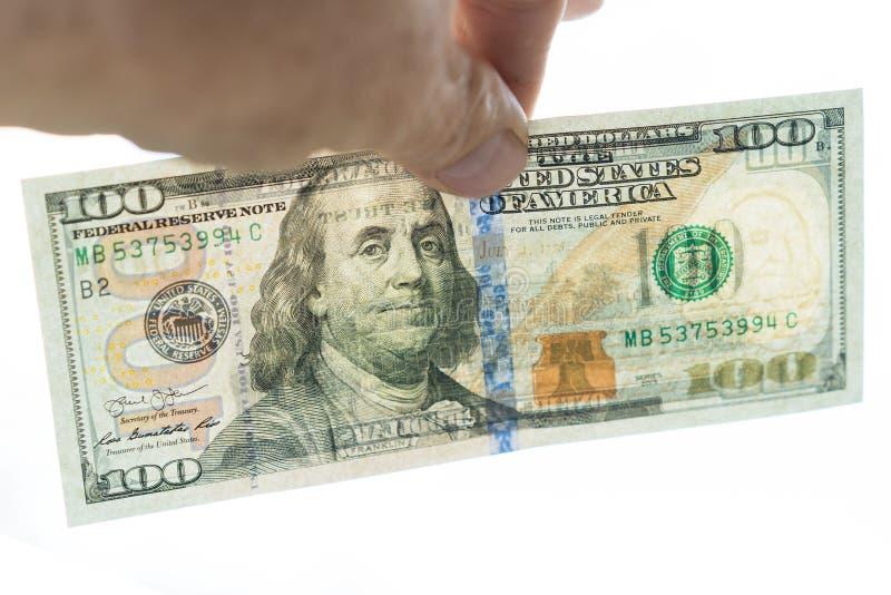 räkning för dollar 100 i handen Den omvända sidan är synlig på ett glimt bakgrund isolerad white arkivbilder