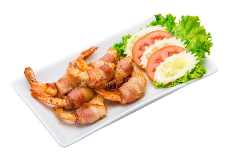 Räkor i bacon royaltyfri foto