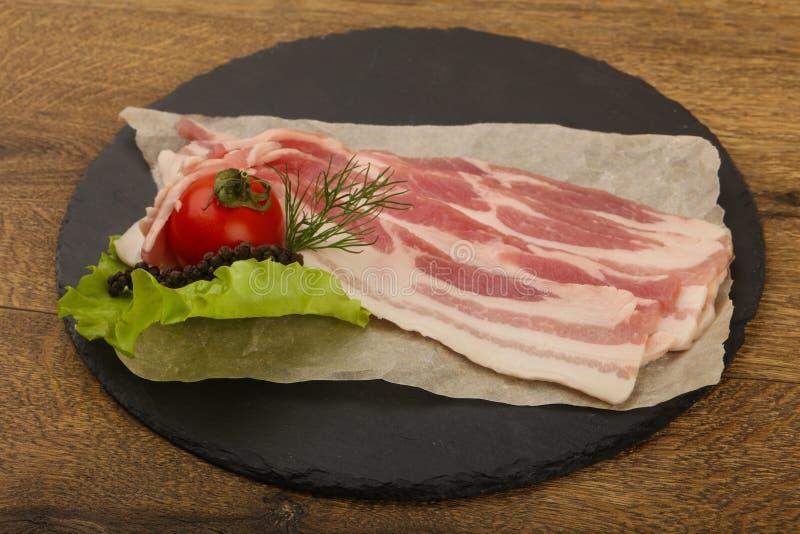 rå bacon royaltyfri foto