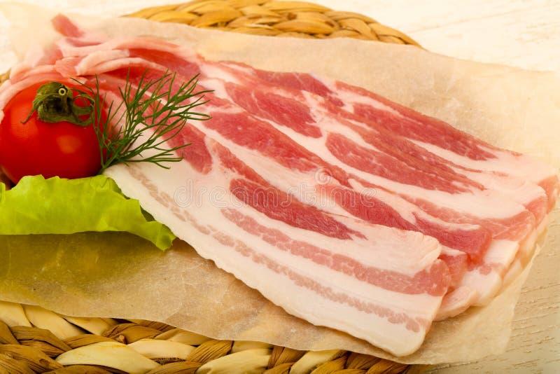 rå bacon arkivfoto