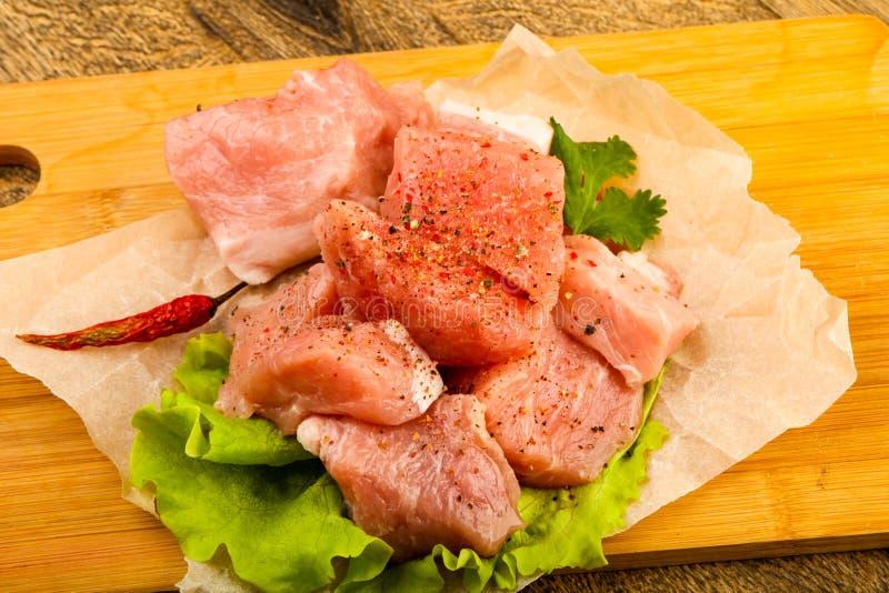 Rå grisköttstycken arkivbild