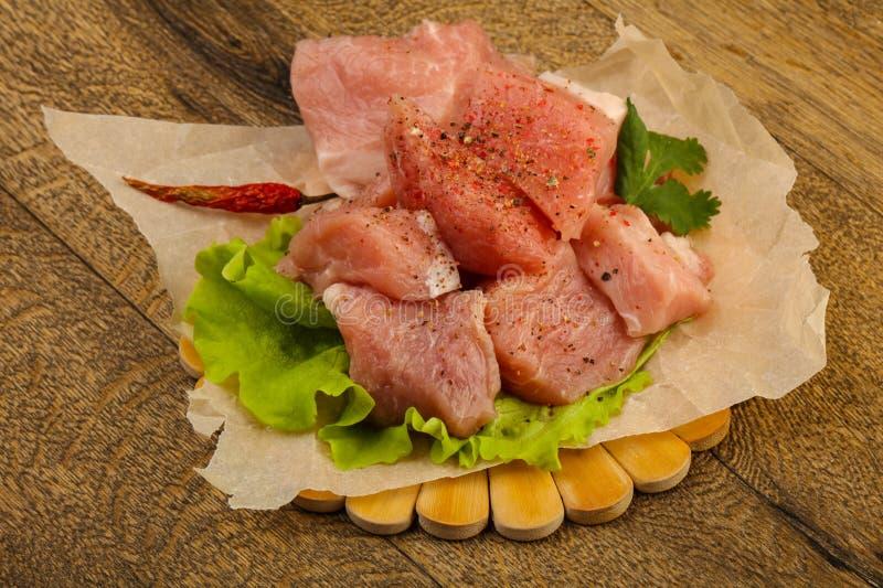 Rå grisköttstycken royaltyfria foton