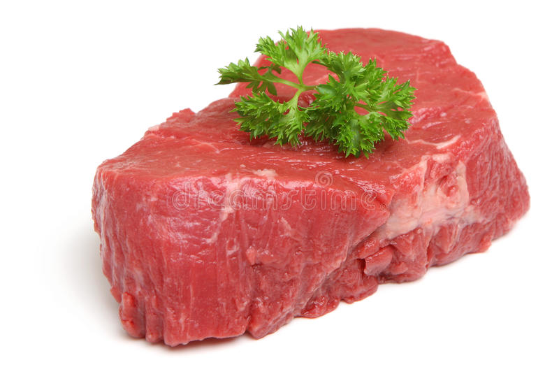 Rå nötköttfilébiff som isoleras på vit arkivbilder