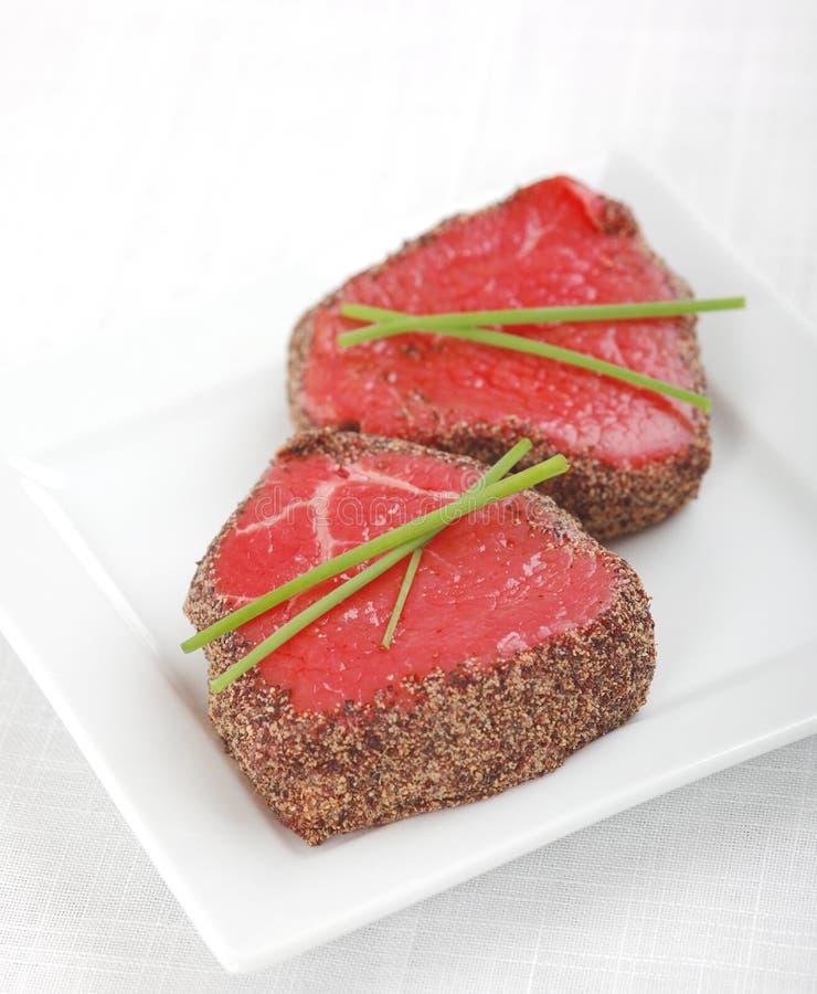 rå steak för peppar royaltyfri foto