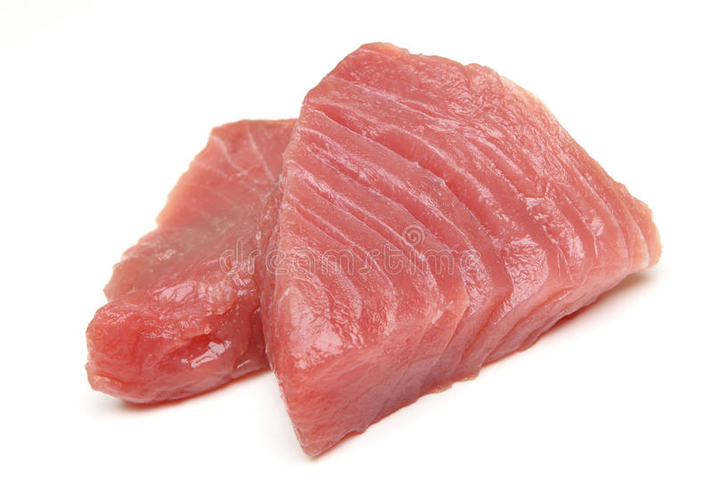 Rå Tuna Fish Steaks arkivbild