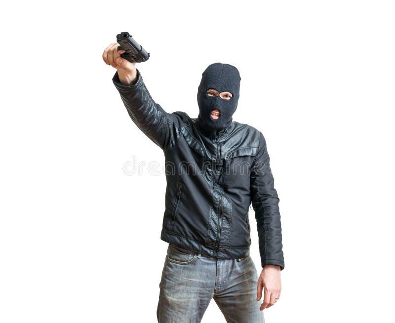 Rånare eller tjuv som siktar med pistolen bakgrund isolerad white royaltyfri foto