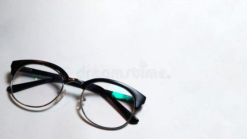Rånglasses_specs på ren bakgrund royaltyfria bilder