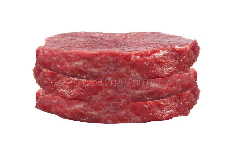 Rått kött på vit bakgrund arkivfoto