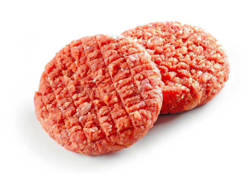 Rått kryddigt hamburgarekött arkivbild