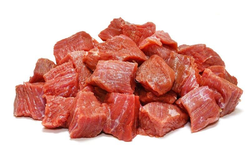 Rått nötköttkött som isoleras på vit arkivfoton