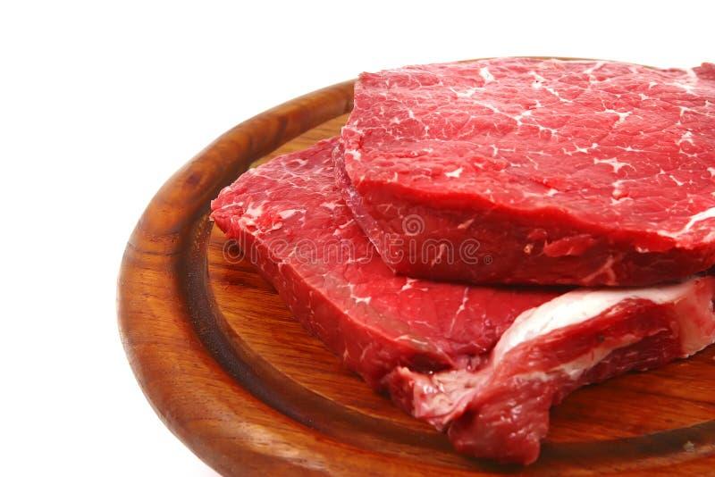 rått trä för meatplatta royaltyfria bilder
