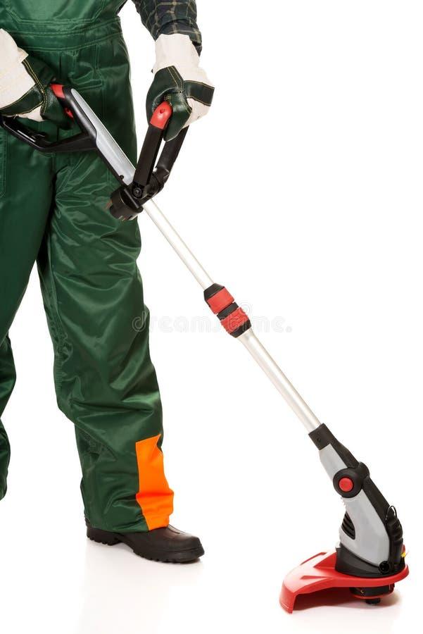 Règlage de jardinier portant les gants protecteurs photo stock