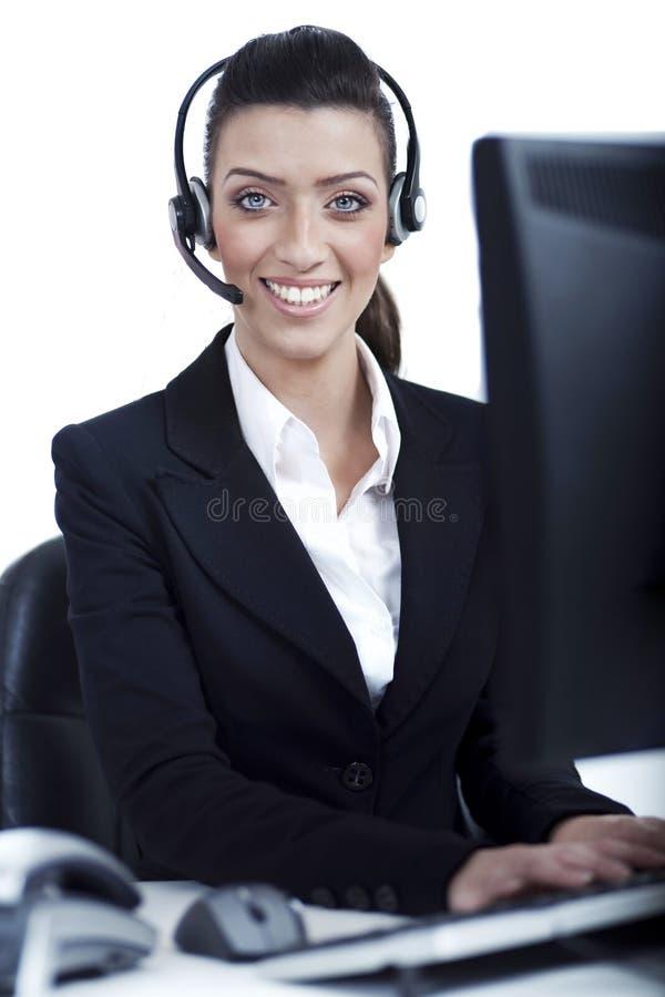 Réceptionniste au travail avec l'écouteur photo libre de droits