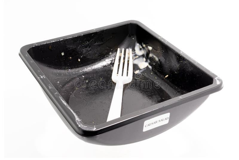 Récipient de nourriture en plastique jetable avec la nourriture de miette image libre de droits