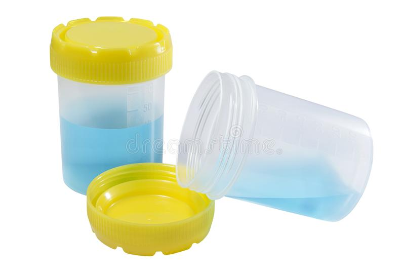 Récipients en plastique médicaux pour la collection de matériel biologique avec les fluides bleus images libres de droits