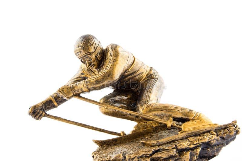 Récompense de statuette de champion de ski d'or photographie stock libre de droits