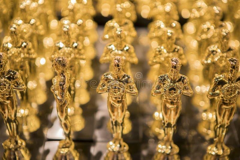 Récompenses d'or dans une rangée photographie stock