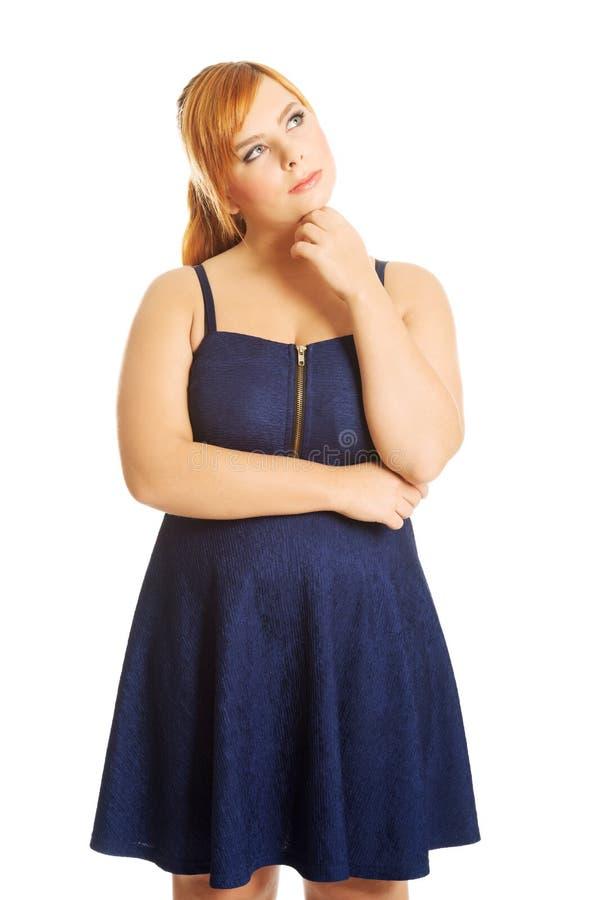 Réfléchi plus la femme de taille images stock