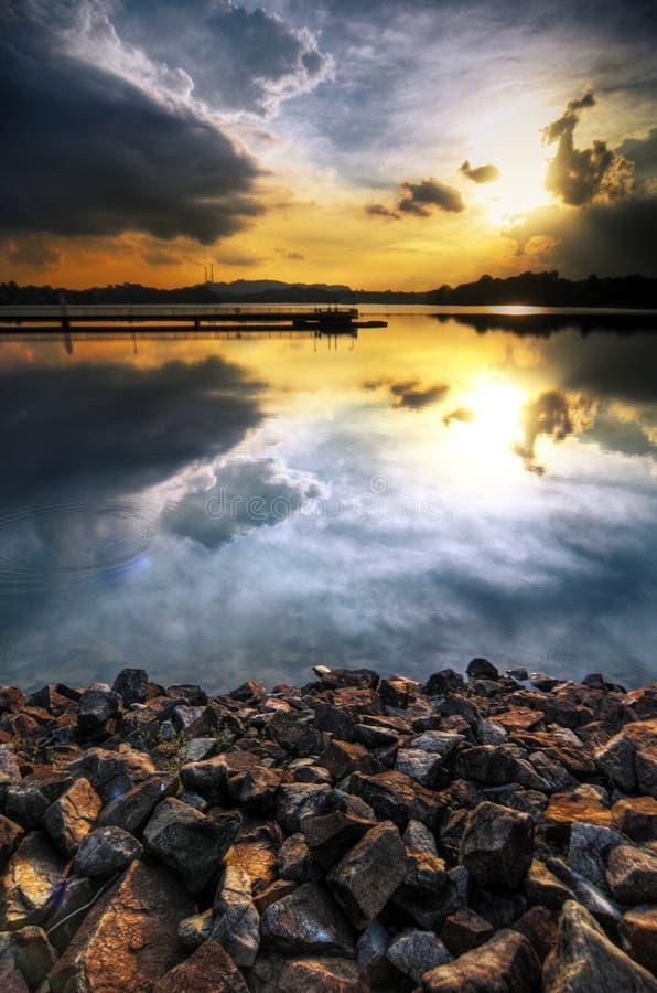 Réflexions du coucher du soleil photo libre de droits