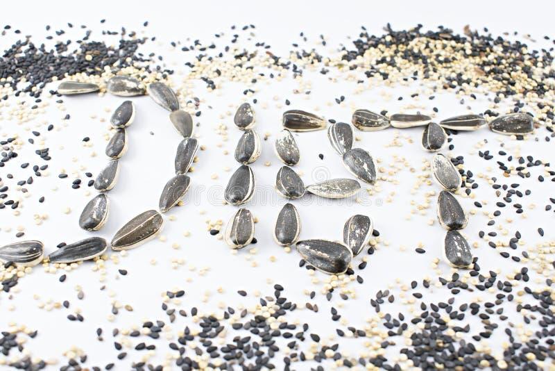 Régime écrit avec des graines photographie stock libre de droits