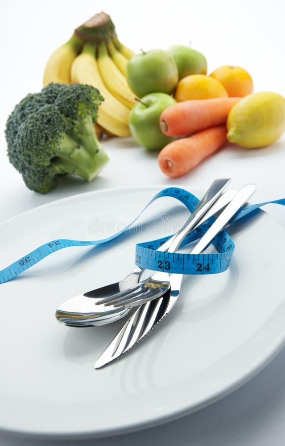 Régime avec des légumes et des fruits photographie stock libre de droits