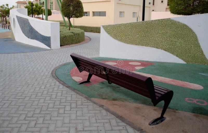 Région caoutchoutée de banc de parc d'enfants photos libres de droits