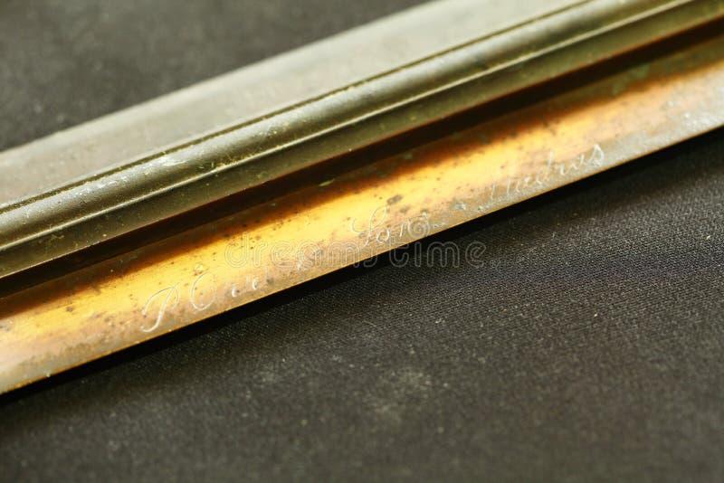 Régua de bronze velha fotografia de stock royalty free