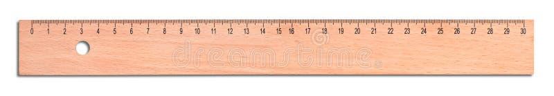 Régua de madeira isolada no branco imagem de stock