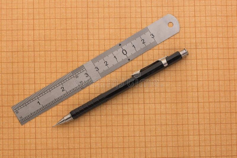 Régua e lápis no papel de gráfico fotos de stock