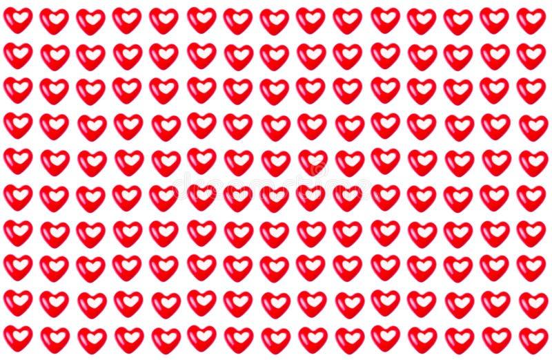 Répétant le modèle des coeurs rouges de Saint-Valentin d'isolement sur un wh photo stock